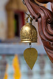 Metal bell with Buddha image in temple. Phuket. Thailand.