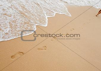 Footprints chain on sand of sea beach
