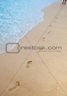 Footprints on sand of sea beach