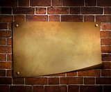 old paper on brick wall background