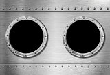 two metal ship portholes