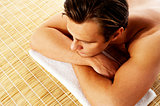 Man relaxing in a spa resort on mat