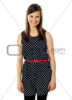 Pretty cheerful trendy teenager posing