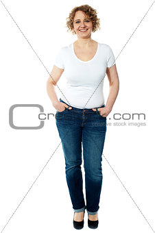 Aged woman posing in trendy casuals