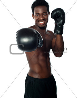 Shirtless african boxer ready to punch you