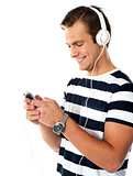 Male teenager with mp3 player and earbuds