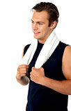 Handsome man with towel around neck