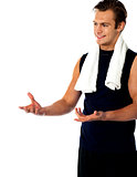 Male trainer posing with open hands and looking away