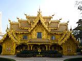 Facade of golden toilet, Wat Rong Khun at Chiang Rai, Thailand