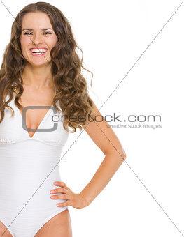 Portrait of smiling young woman in swimsuit