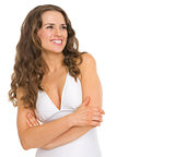 Happy young woman in swimsuit looking on copy space
