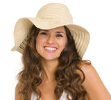 Portrait of smiling young woman in hat
