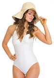 Glamour young woman in swimsuit and hat