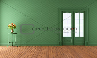 Empty green living room with sliding door