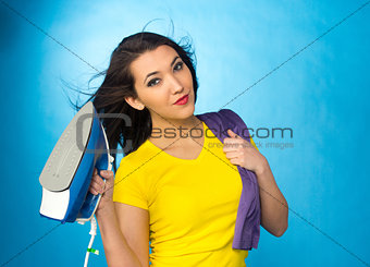 Houseworks, woman hold an iron in hand