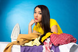 Houseworks, woman with pile of clothes for ironing
