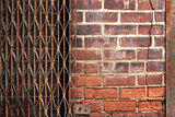 Urban Brick Backgound With Rusty Gate