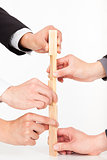 hands of business group building by wooden block