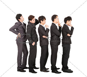 Group of businessman standing in a line waiting
