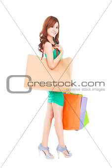 full length of happy woman with shopping bag