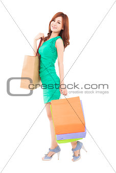full length of beautiful woman with shopping bag