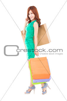 full length of smiling asian woman with shopping bag