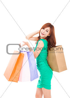 happy young  woman holding shopping bag