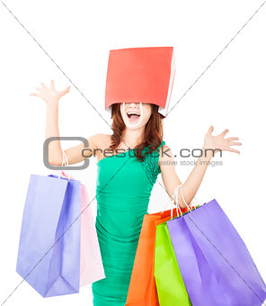 excited young woman with shopping bag on the head