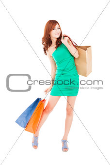 full length of happy asian  woman with shopping bag