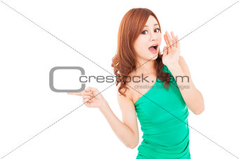 surprised young woman shouting and pointing