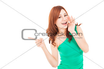 smiling asian young woman shouting and pointing