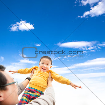happy child playing with his father