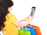 young woman holding shopping bags and calculator