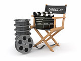 Movie industry. Producer chair, lapperboard and film reel.