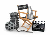 Movie industry. Producer chair, ñlapperboard and film reel.