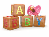 Baby from alphabetical blocks and dummy