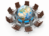 Concept of global business communication. Laptops and armchairs around table with earth