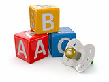 ABC blocks cube and baby's dummy