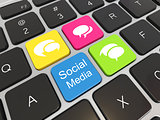 Social media on laptop keyboard.