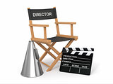 Movie industry. Producer chair, lapperboard and bullhornl.