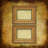 Two empty baroque golden frames on Victorian floral texture
