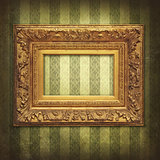 Golden frame on a grunge Victorian wallpaper