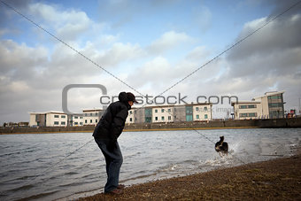 A  male dog  by the water