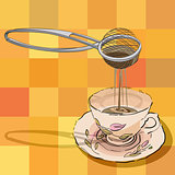 tea strainer and cup