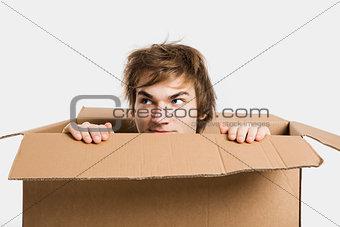 Man inside a card box