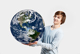 Man holding  the planet earth