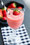 Fruit smoothie and strawberries