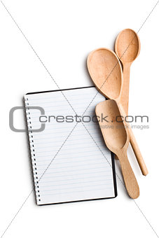 blank recipe book with kitchen utensils