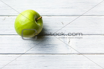 green apple on white kitchen table
