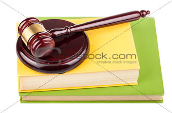 Brown wooden gavel and books